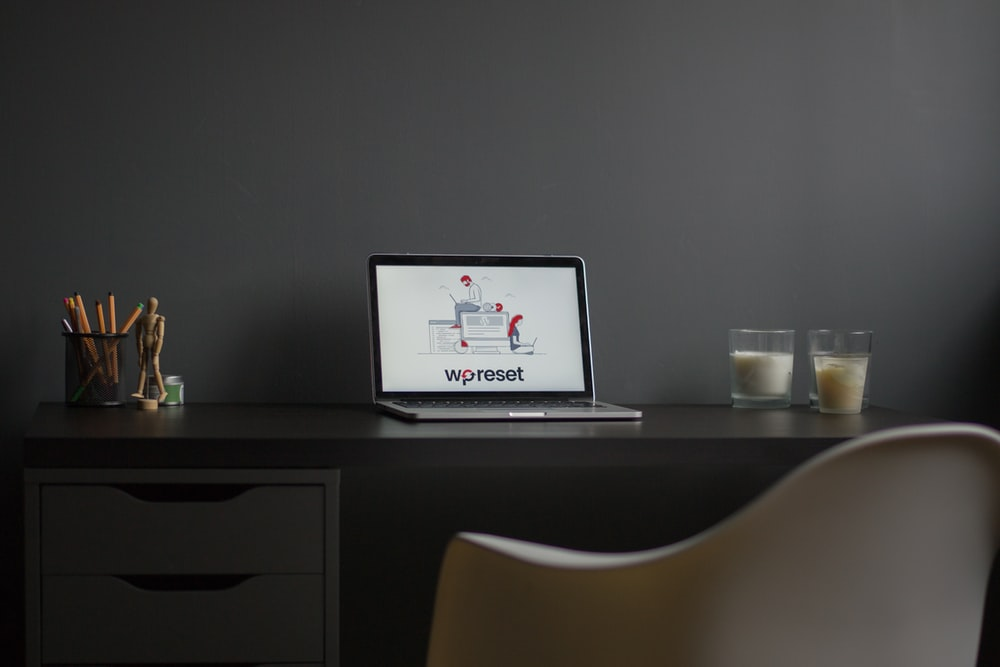 macbook air on black wooden desk