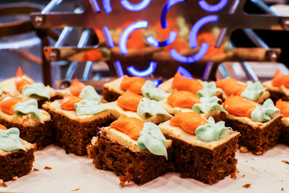brown bread with sliced tomato and green vegetable on white ceramic plate
