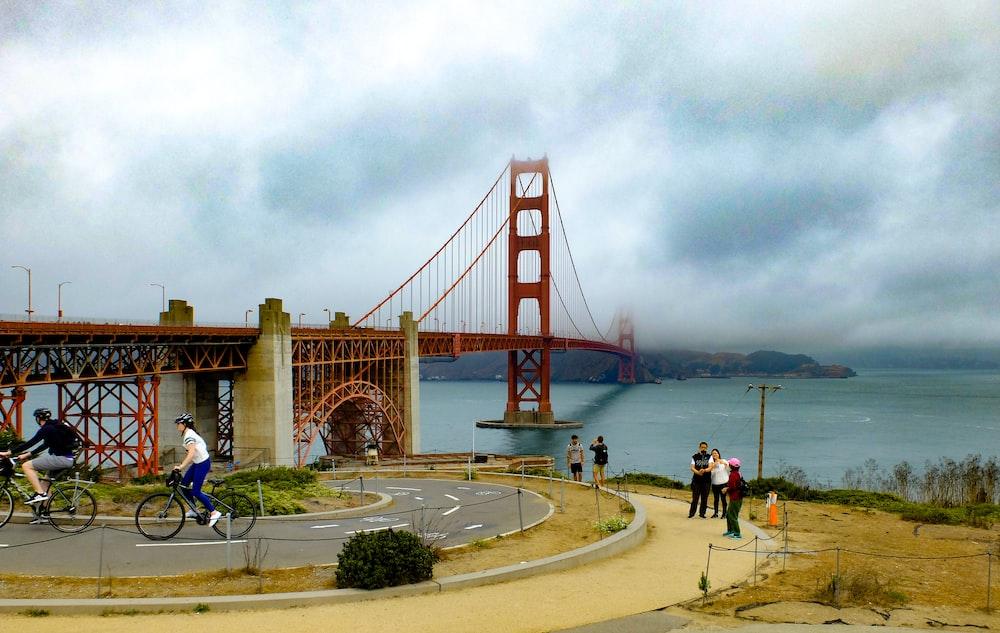 people walking on gray concrete bridge during daytime