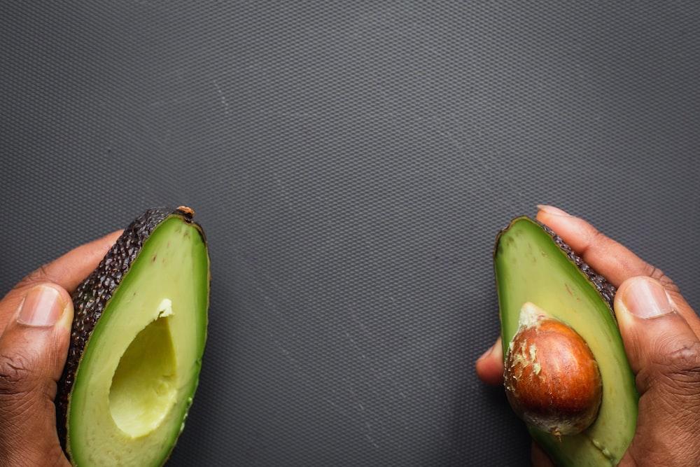 sliced green fruit on black textile