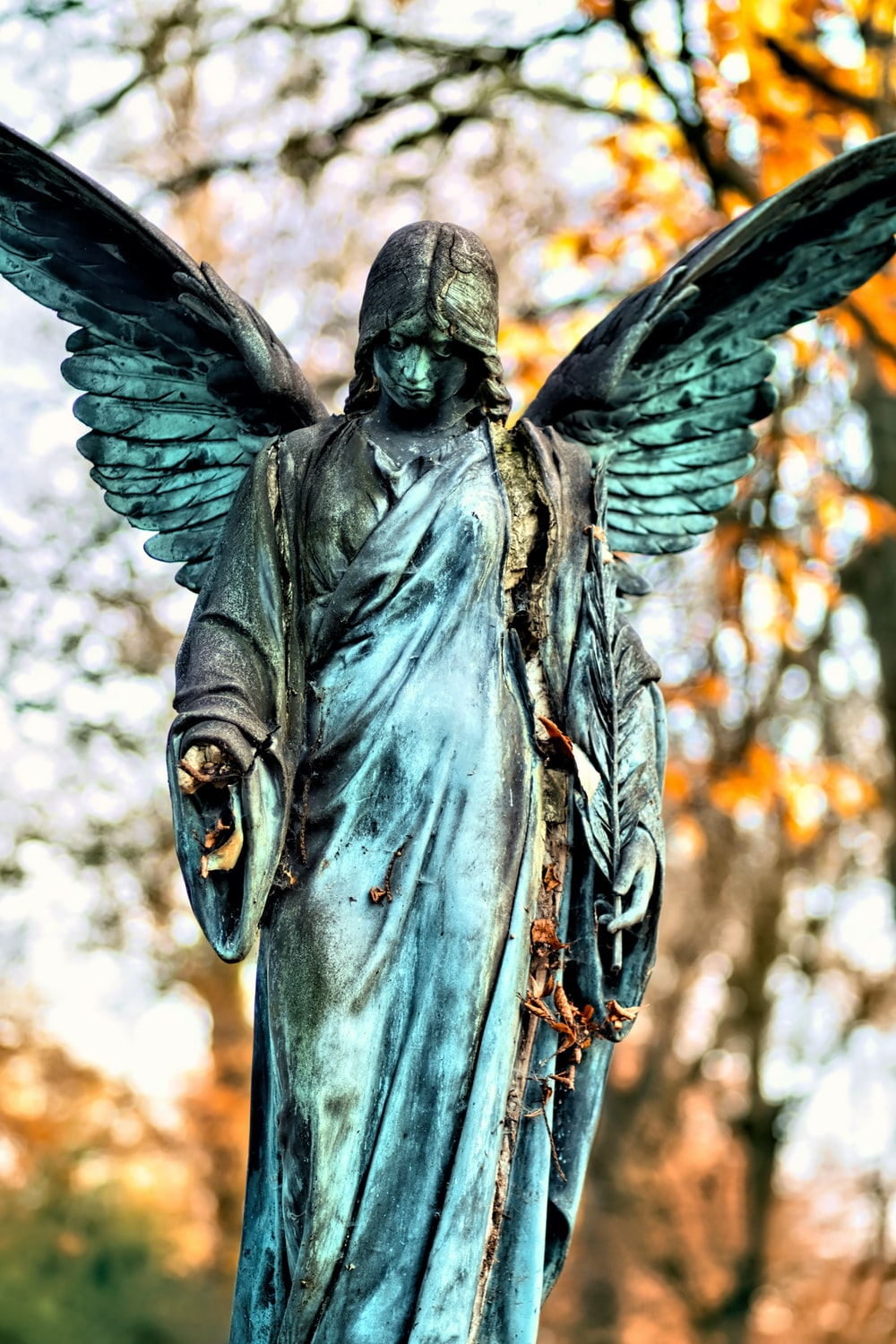 angel statue in close up photography