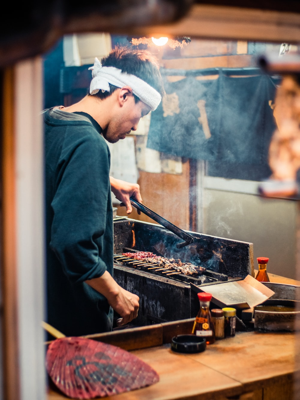 man in blue long sleeve shirt cooking