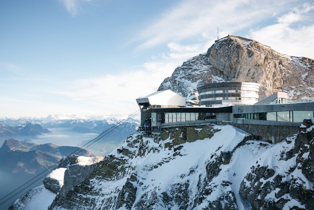 white and brown house on top of mountain