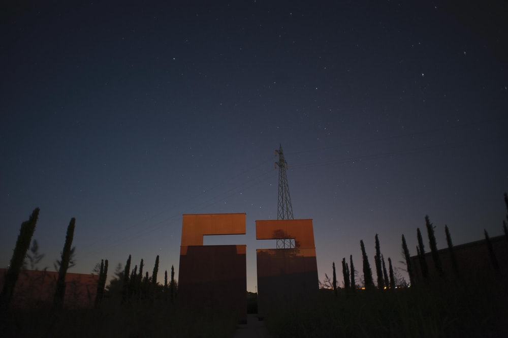 brown and white cross under blue sky during night time