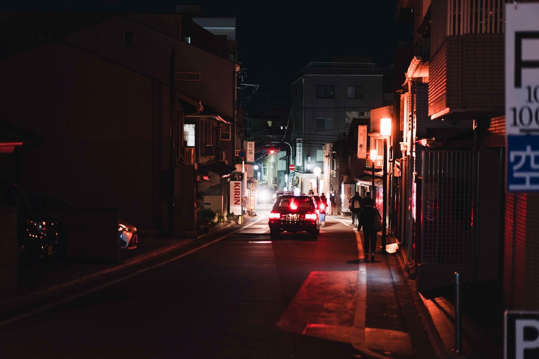 Red Car On Road During Night Time - unsplash