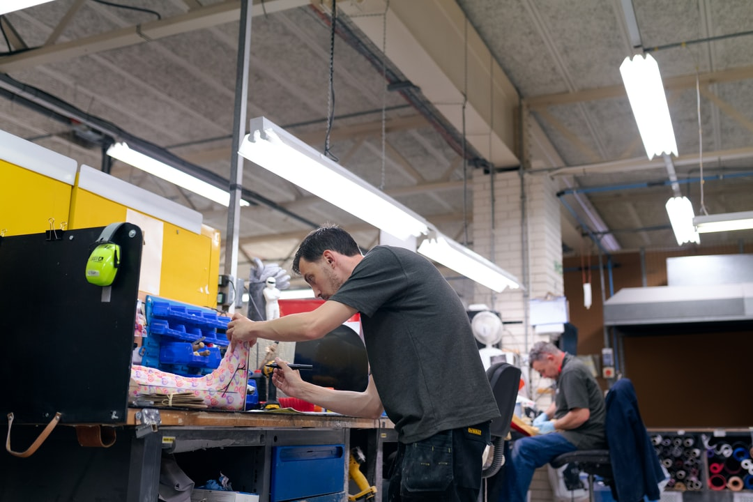 Male orthotic technician engineer makes personalised leg cast
