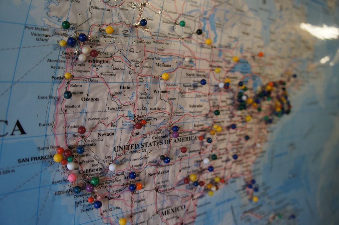 A map of the United States with tacks stuck in the map from visitors from around the world.