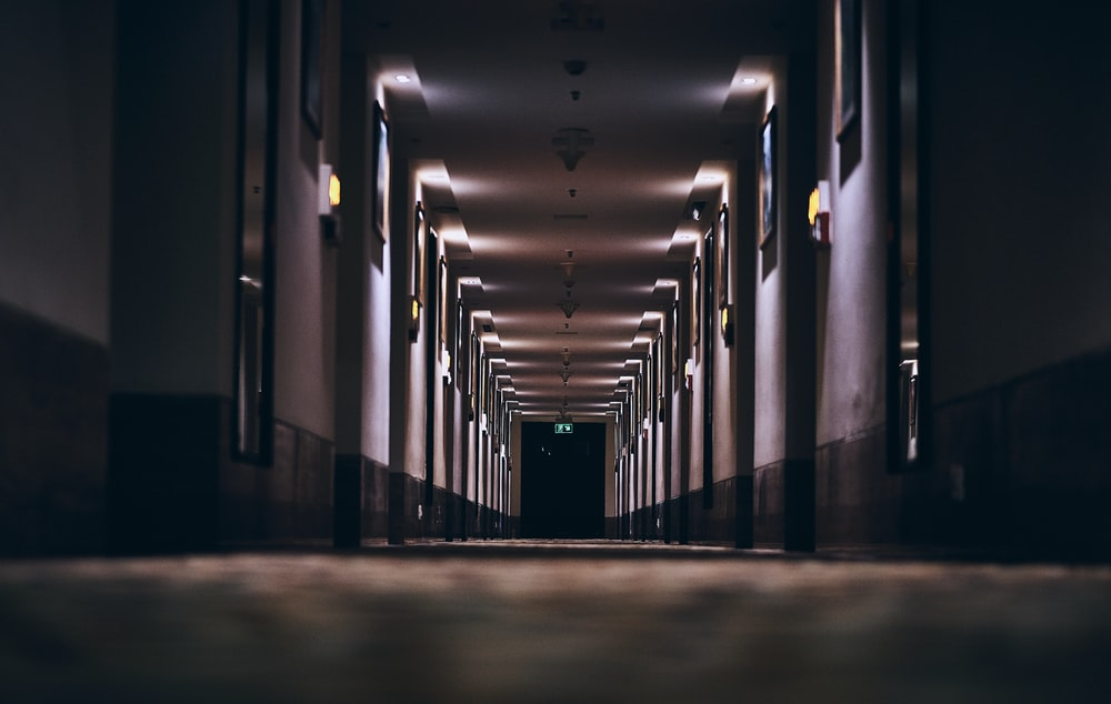 hallway with lights turned on in a hallway