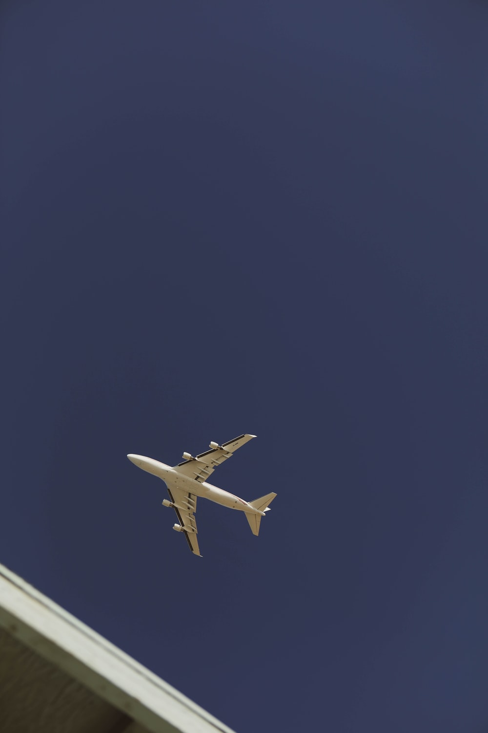 white airplane in mid air during daytime