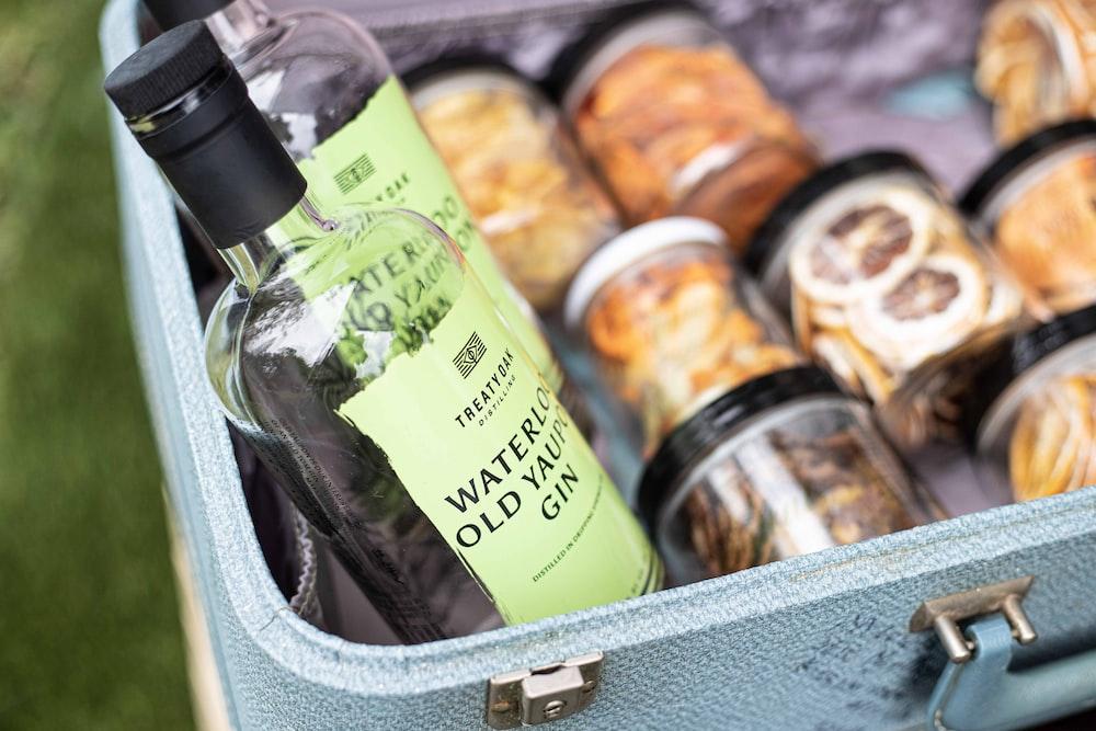 olive oil bottle in green basket