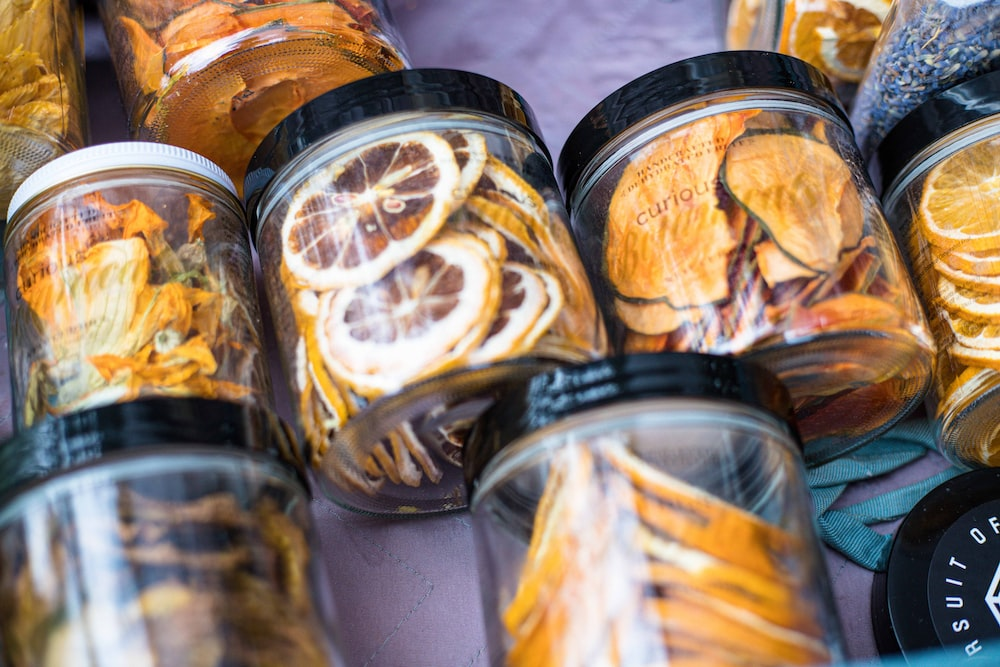 clear glass jar with brown and yellow food