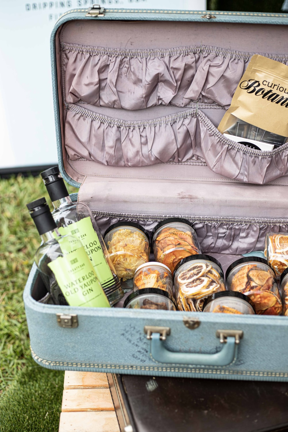 assorted bottles in gray suitcase