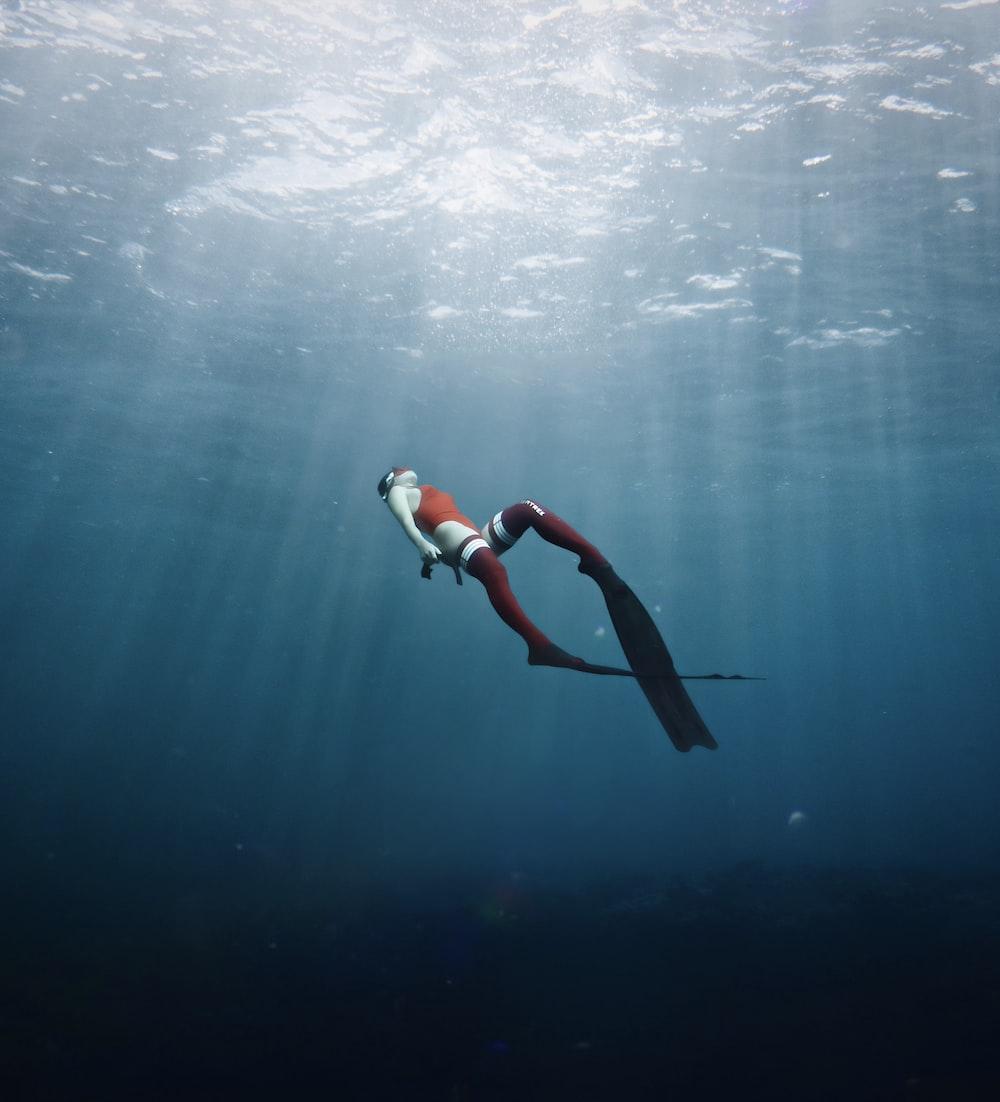 woman in white and black bikini swimming in the sea