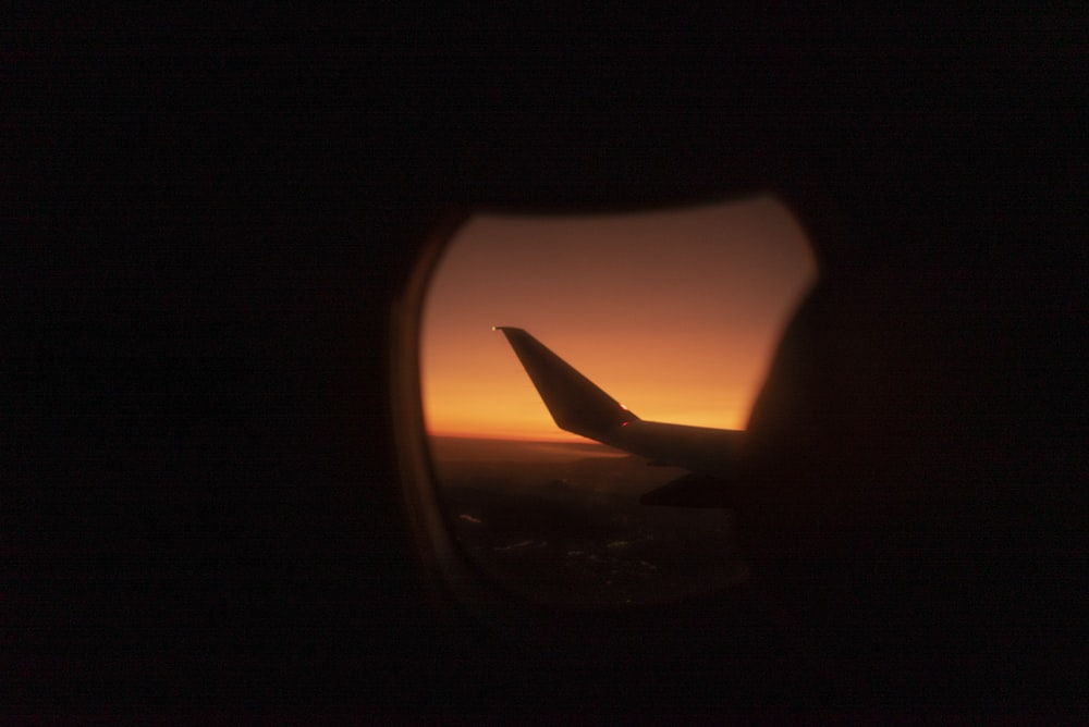 airplane wing during golden hour