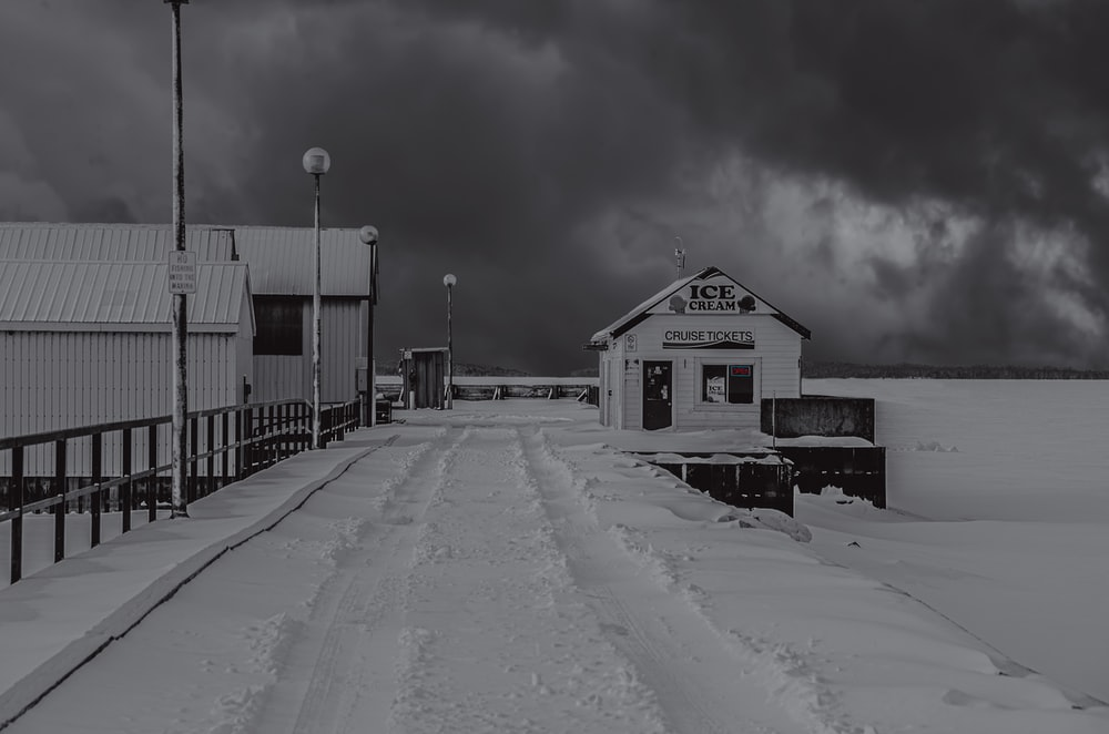 white and gray building under white sky