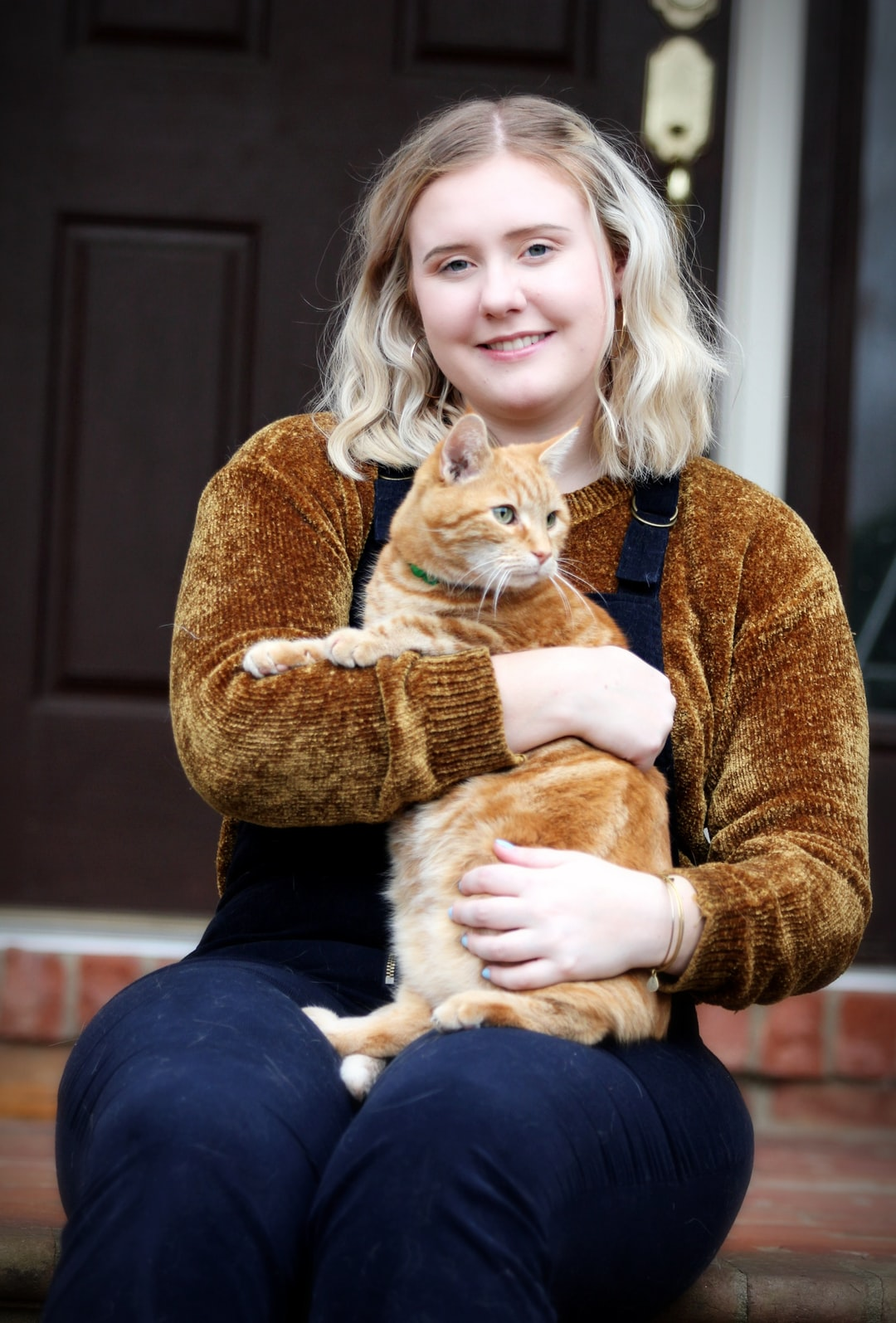 A girl holds a cat