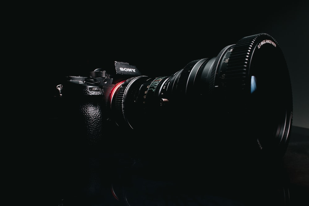 black sony camera on black surface