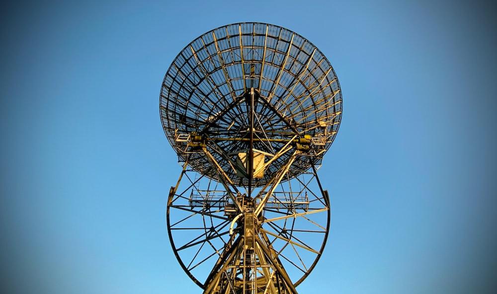 gray satellite dish under blue sky