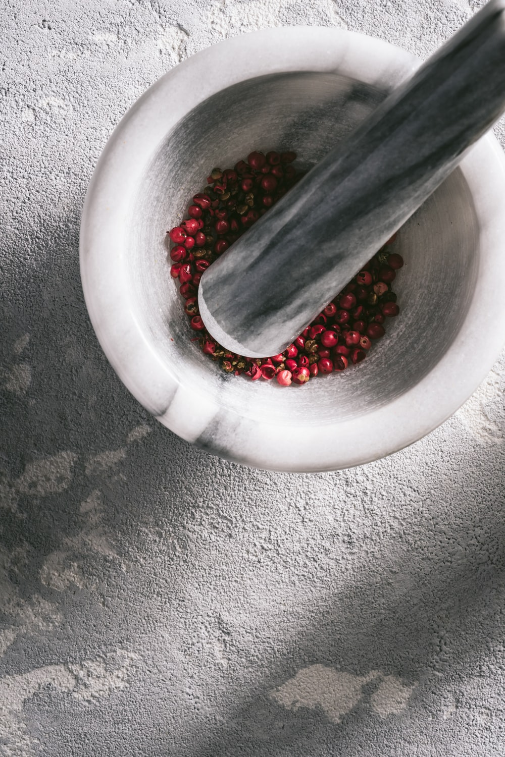 red beads in white round bowl