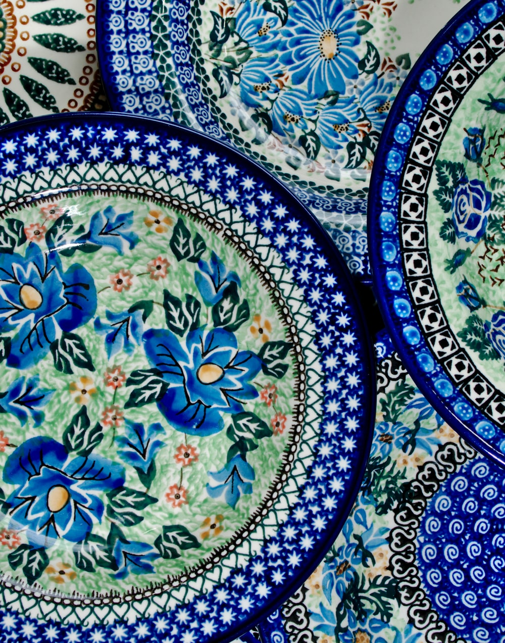 blue green and white floral ceramic plate