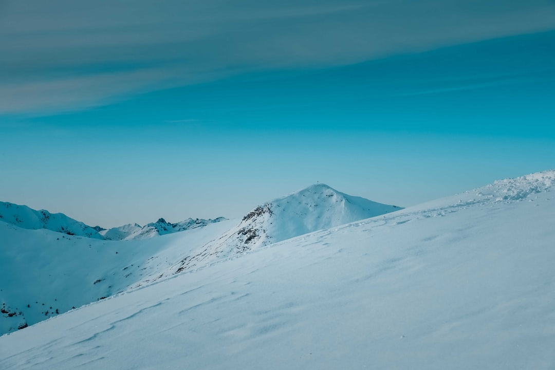 Snow Covered Mountain Under Blue Sky During Daytime - unsplash