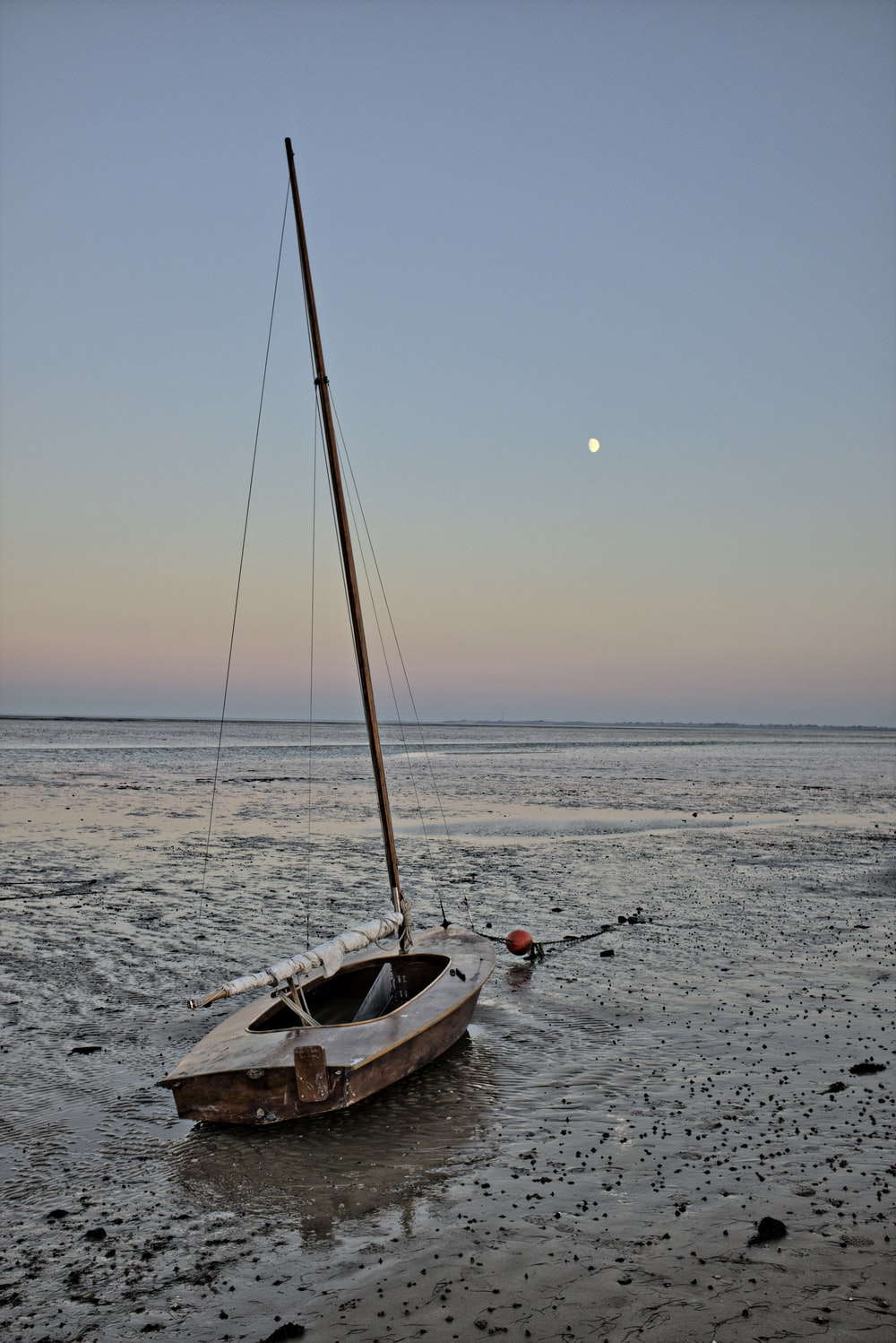 white and brown boat on sea during sunset