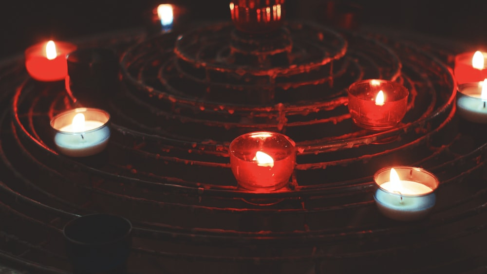 red candles on black surface