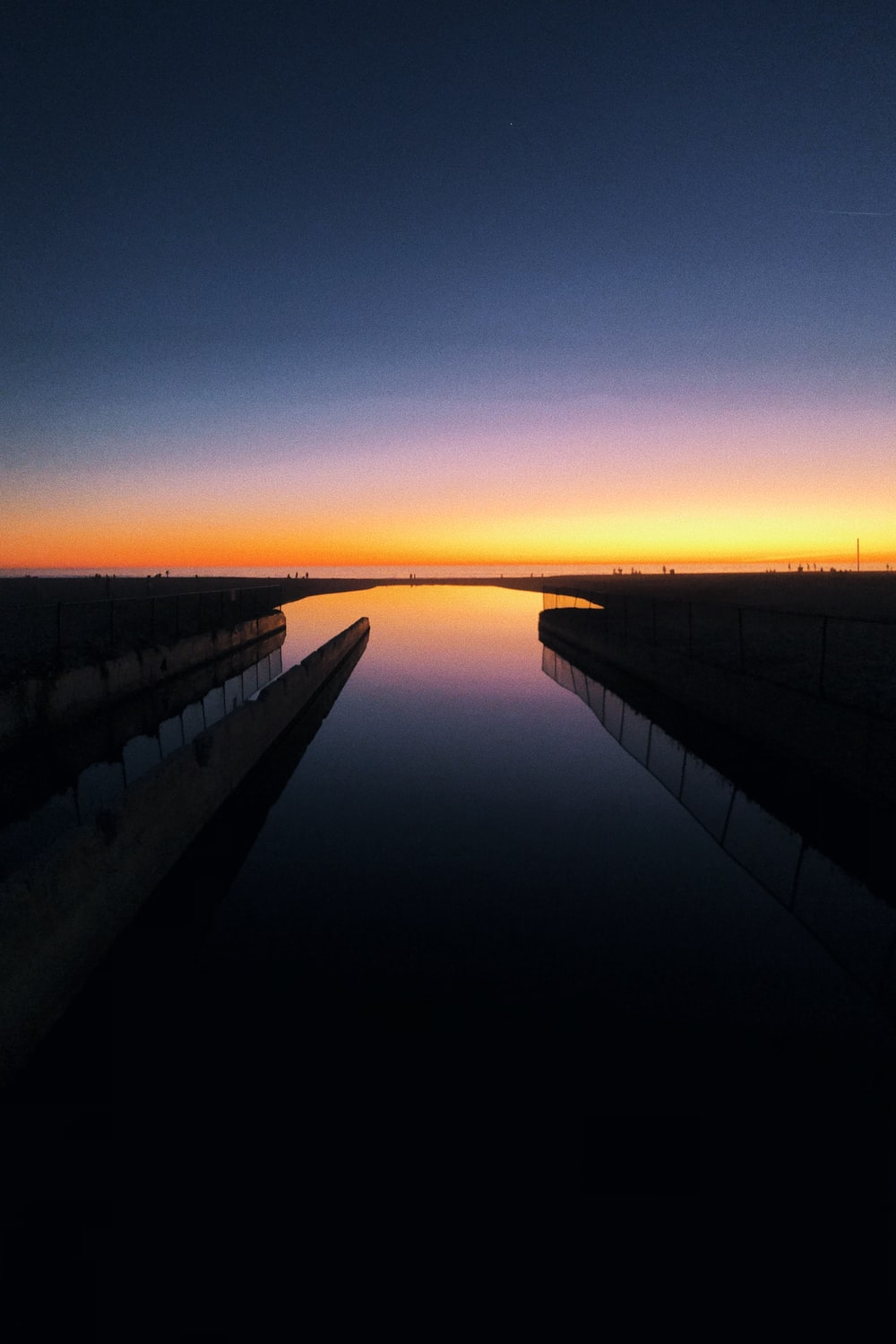 black and white train rail during sunset