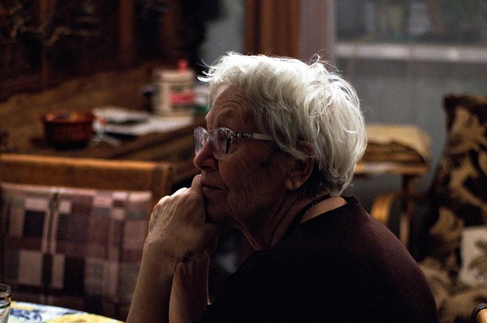woman in black shirt wearing eyeglasses
