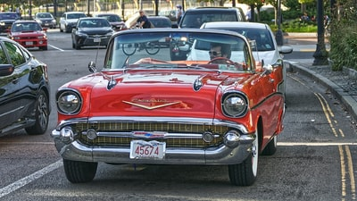 red chevrolet car on road during daytime massachusetts zoom background