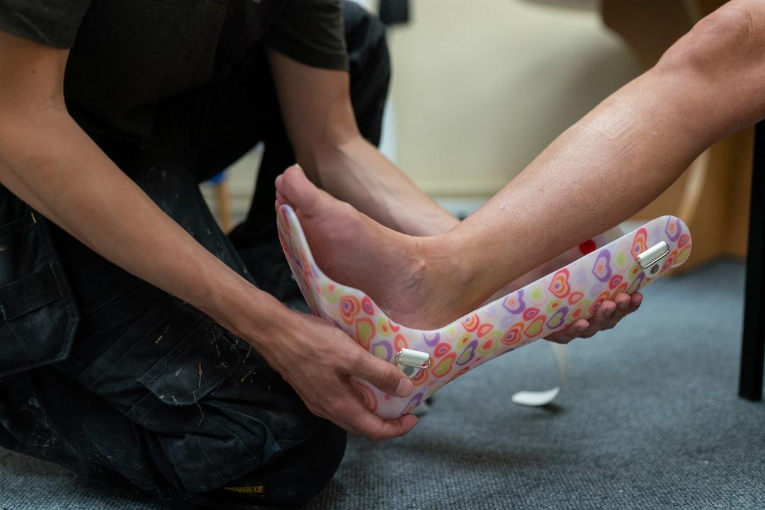 Male orthotic technician engineer fits personalised leg splint