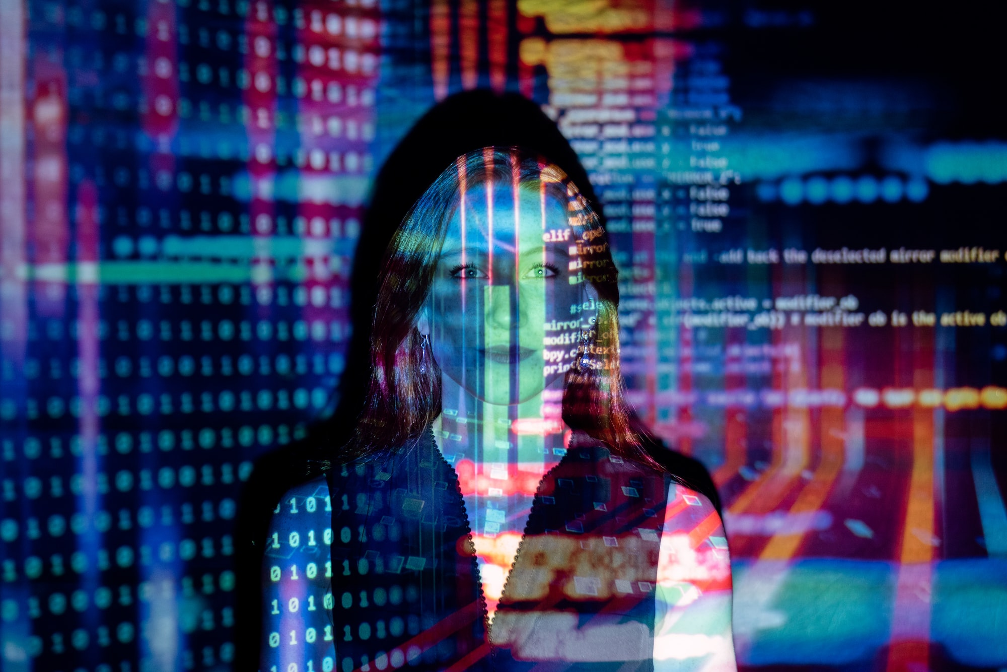 Female software engineer with projected code