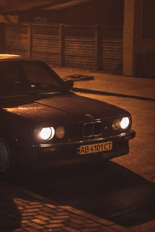 black mercedes benz car on road