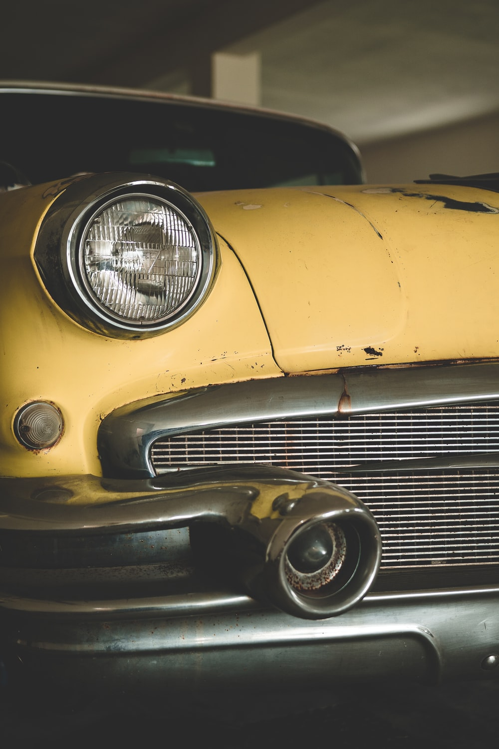 yellow car with black and silver wheel