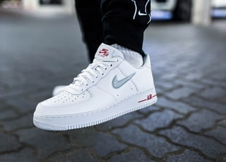 person wearing white nike air force 1