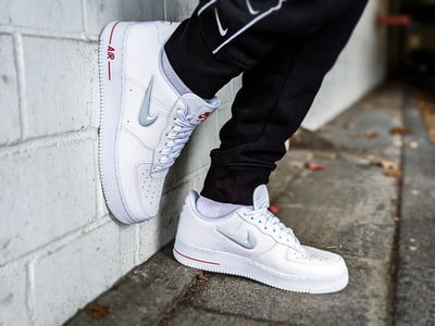 person in white nike air force 1 high