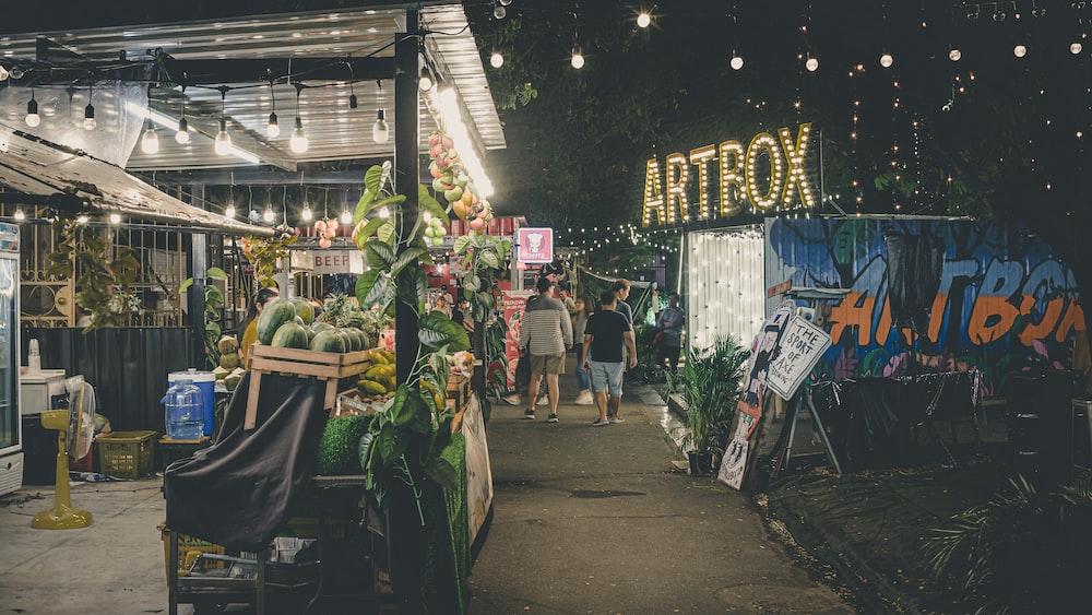 people walking on market during nighttime