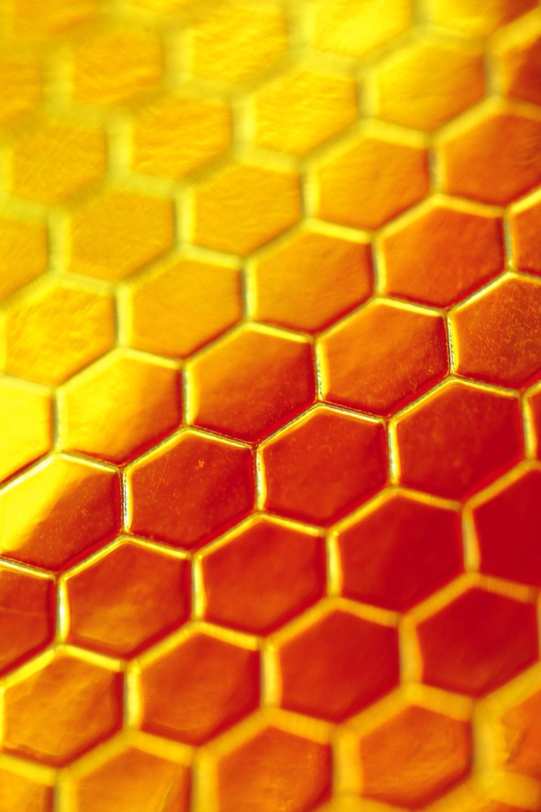 Festive shiny gold hexagon honeycomb vertical background