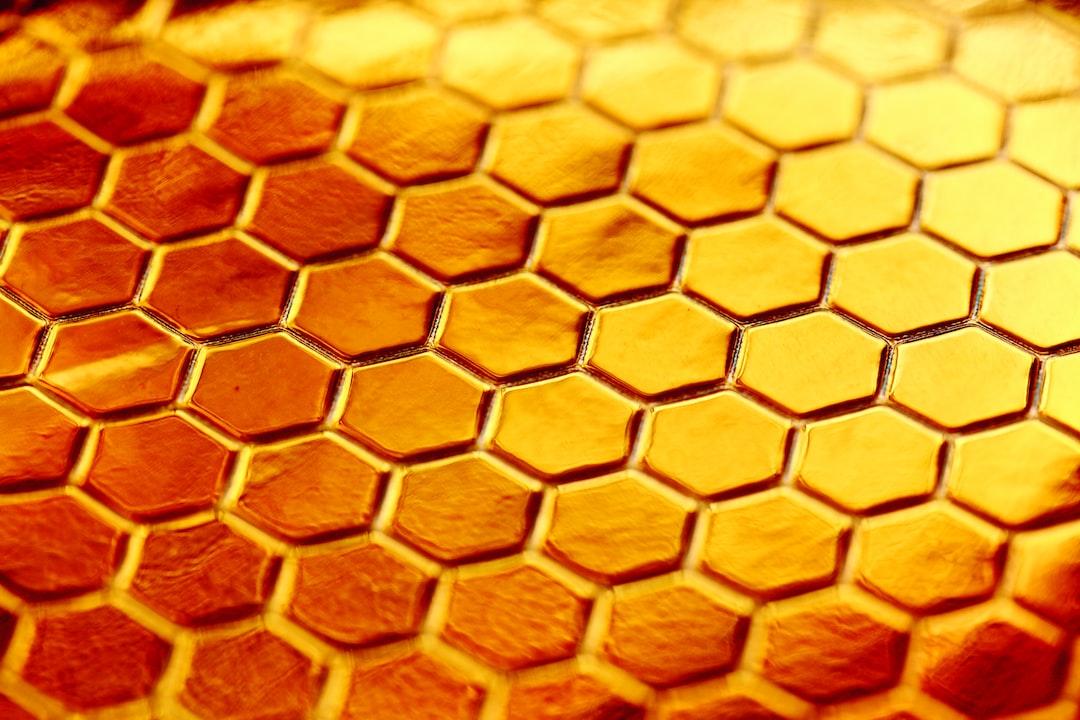 Festive shiny gold hexagon honeycomb background