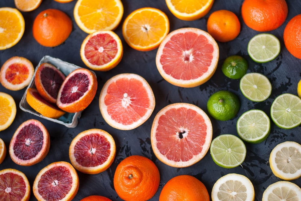 sliced orange fruits on black surface