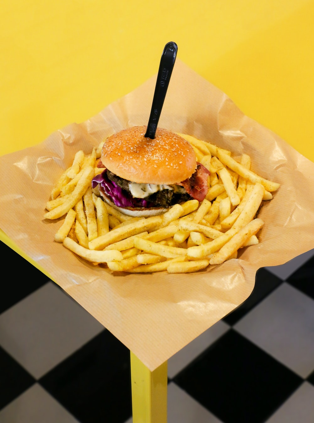 burger with fries on white paper