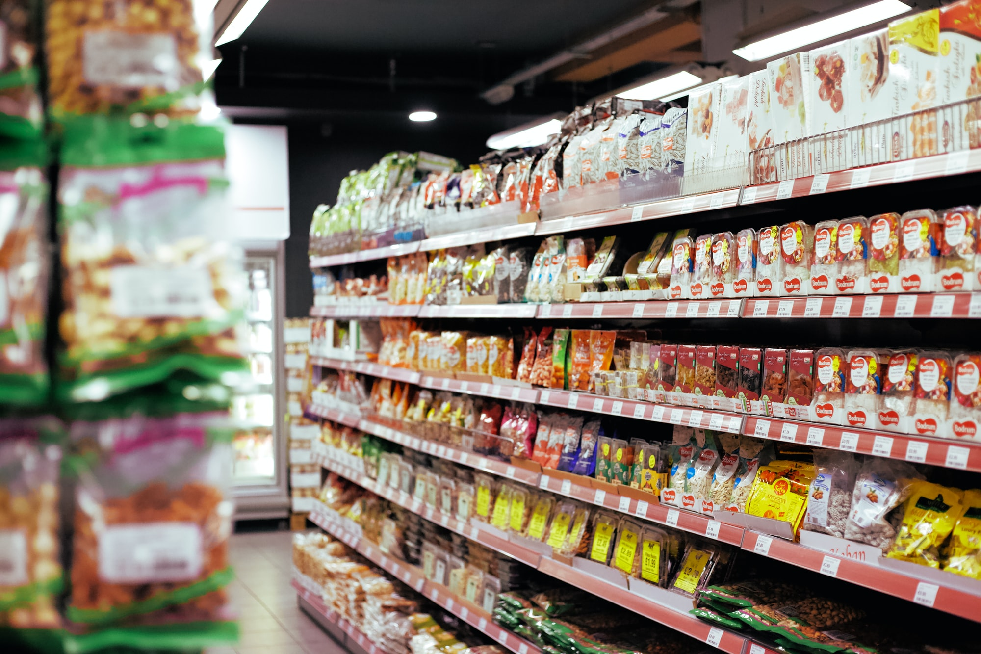 A supermarket aisle with dry ingredients.