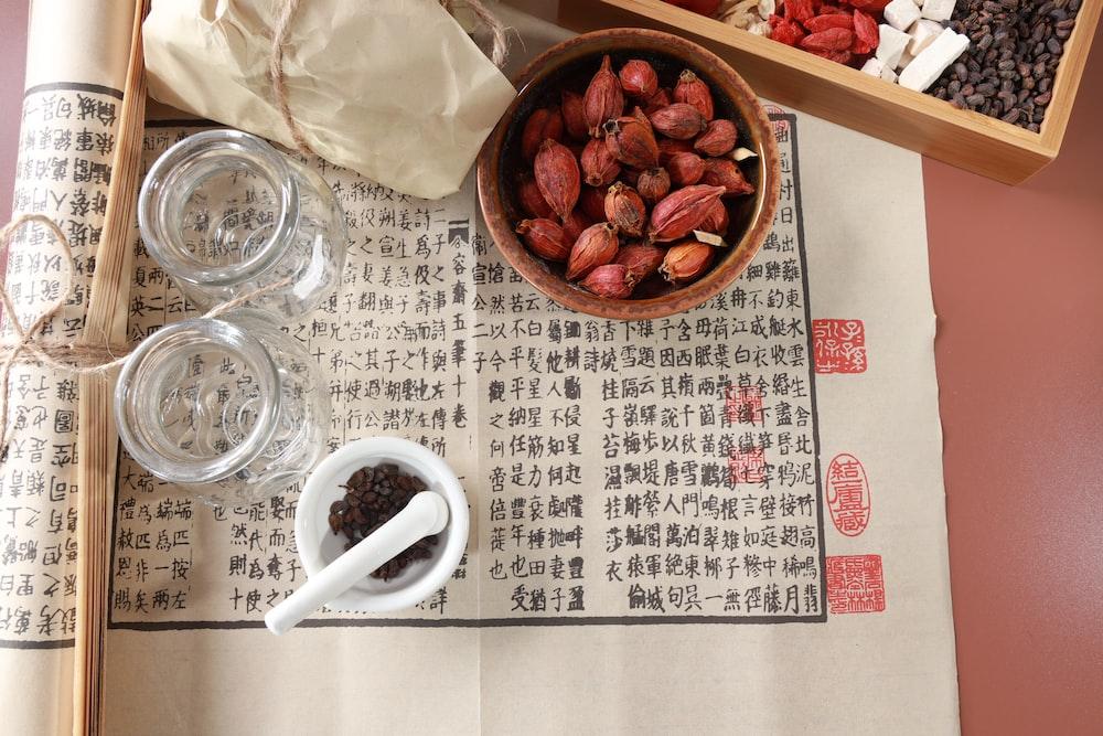 white ceramic mug on white and brown table cloth