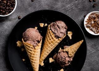 waffle with chocolate ice cream on black round plate