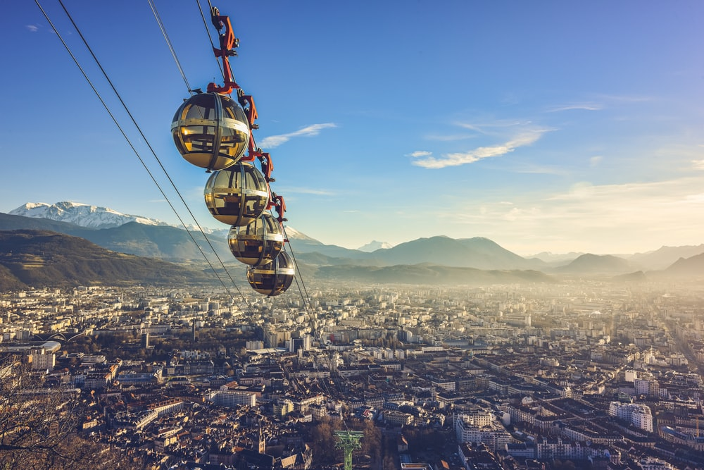 yellow and black cable car over city during daytime