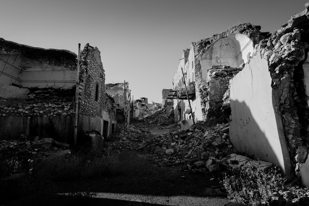 grayscale photo of concrete houses
