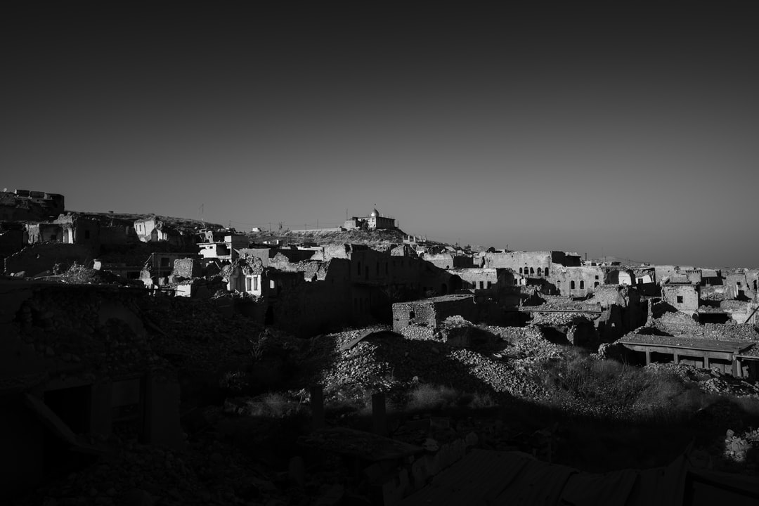 Black and white version of a view looking toward the Shia shrine of Sayida Zeyneb, recently rebuilt overlooking the ruins of Shingal (Sinjar) after the shrine and the rest of the town was destroyed during war with the Islamic State.