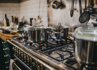 stainless steel cooking pots on gas stove