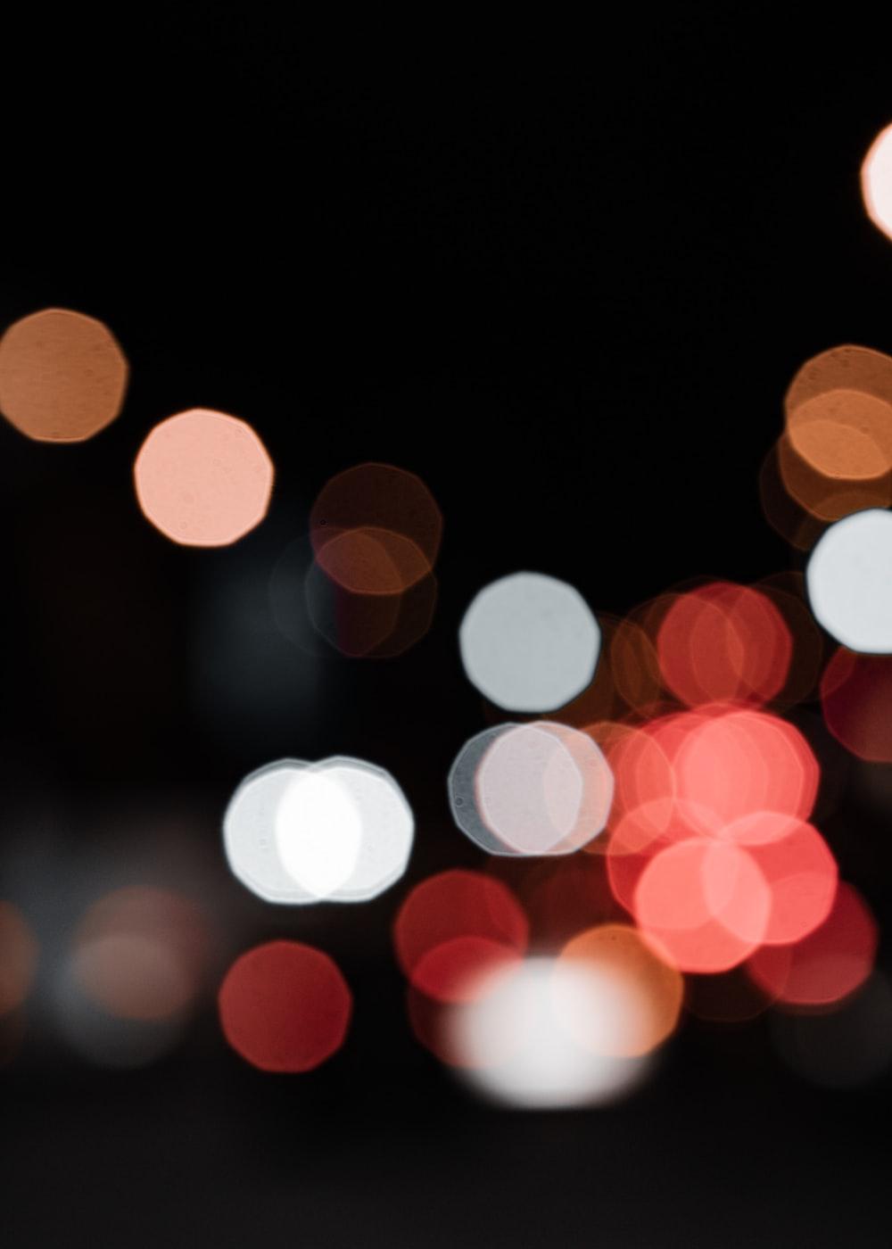 white and orange bokeh lights