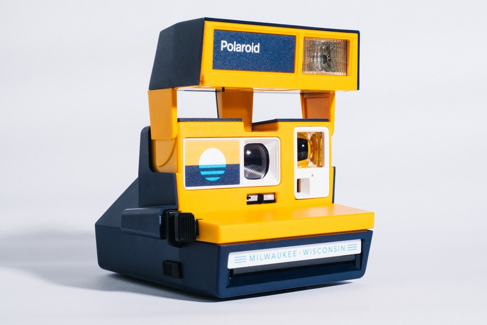 yellow and black polaroid instant camera